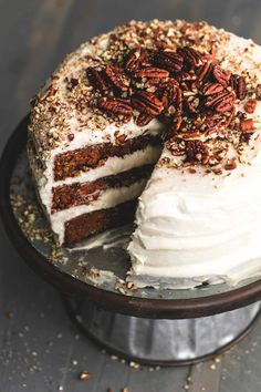 Simple and moist world's best carrot cake from scratch with cream cheese frosting. | lecremedelacrumb.com