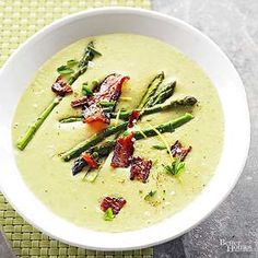 This will be your new favorite asparagus soup recipe! Blend cooked potatoes, asparagus, and milk to create the creamy base; top with a few extra asparagus spears and bacon./