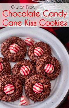 Make the holidays even sweeter with these gluten free Chocolate Candy Cane Kiss Cookies. A chocolate cookie, rolled in sprinkles, topped with a peppermint cane cane kiss.