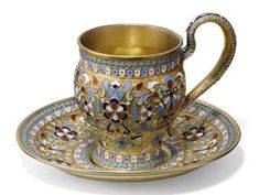 A RUSSIAN SILVER-GILT AND CLOISONNE ENAMEL TEACUP AND SAUCER
