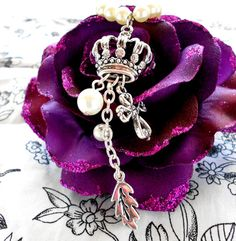 This is a beautiful hand-crafted pearl necklace with crown pendant. Comes from Angel's Boutique on Etsy. Lovely jewelry!