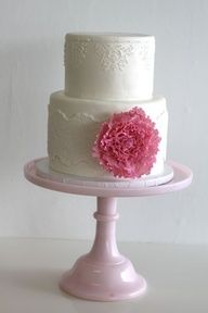 a cute little cake so you could have a wedding cake  Shabby chic cake with white on white lace and large bright flower