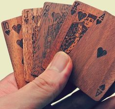 A couple questions here on these wooden cards: How do you shuffle them? Couldn't you memorize the grains and shades of the wood on the aces? Splinters? When playing Go Fish can you ask 'Do you have wo...