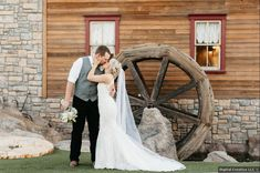 wedding portrait in front of large wooden water wheel, country wedding inspiration