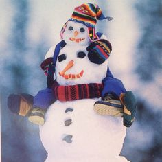 Coolest snowman ever!  Todder baby snowman riding daddy piggyback style!
