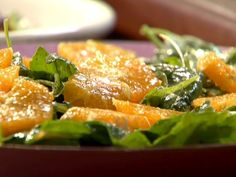 Get this all-star, easy-to-follow Spinach and Arugula Salad with Orange recipe from Rachael Ray