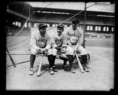 Babe Ruth, Bob Shawkey, and Lou Gehrig,NYY, sitting on a batting practice backstop on the field at Comiskey Park, Chicago, Illinois, 1930.