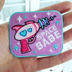 SPACE ♥ BABE  The perfect patch for all the intergalactic cuties out there, exploring the voids & taking no prisoners. Show off your cosmic babliness to all the mere humans of planet earth before heading out to pluto for snow cones, or mars to work on your tan ♥  ♥ 2.5 x 3.5 inches  ♥ Iron o...