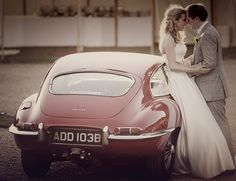 E-Type Jag and wedding couple at Grittenham Barn Wedding