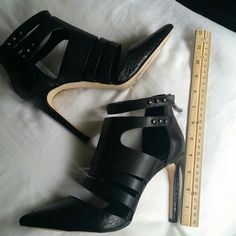 BCBG Strappy Bootie Worn once for an hour, theyre too big for me, Paid $75. Leather snd man-made upper, heel and toe are faux snake pattern. Beatiful classy shoes accent any outfit! BCBGeneration Shoes