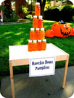 Halloween Games Pumpkin Knock Down  http://www.one-stop-party-ideas.com/Halloween-Kids-Games.html