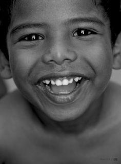 An heartfelt smile by Praveen Guna, via 500px