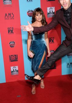 Darren Criss jumping in front of Lea Michele