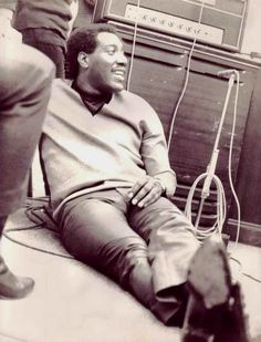Ottis Redding recording in the studio.