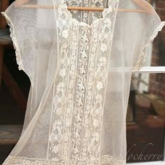 an old lace dress.. I want one.....April has a top like this that is to die for