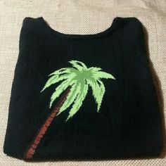 """100% Cashmere 3/4 Sleeve Palm Tree Fitted Sweater From Rodeo Drive in Beverly Hills is this beautiful 100% cashmere 3/4 length sleeve fitted sweater with a Palm Tree front. On trend. Excellent/good condition.  No holes/ stains/ pilling, etc.,  MEASUREMENTS: Bust: 32"""" Shoulder to hem: 21"""" Arm length: 21"""" Sweaters"""