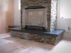 For this fireplace, the homeowner wanted a concrete hearth that wouldn't compete with the bricks that make up the rest of the piece. Concrete-Visions chose a dark gray colored concrete for the job. What a beautiful beginning!
