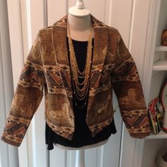 Vintage animal print  jacket,fits like a med. Heavy tapestry type material ,browns and blacks and creams  L.23 SL.29 from neck W. 42 arm pit to arm pit excellent condition Jackets & Coats