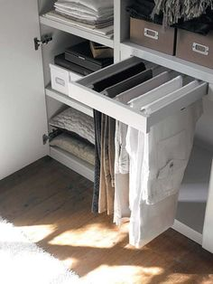 Or install a slide-out bar for hanging trousers. | 53 Seriously Life-Changing Clothing Organization Tips