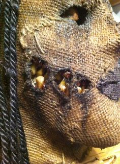 Teeth tear away on female scarecrow mask.