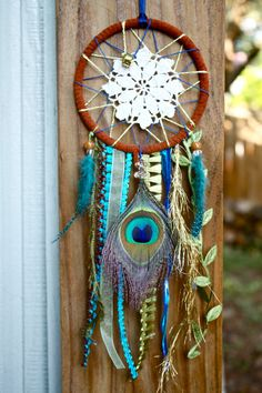 Dreamcatcher - Doily, Peacock feather design w/ blue and green. via Etsy
