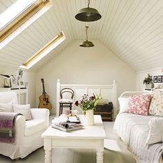 attic guest room, a slanted plank wood ceiling solution, multiple pendants. Love this!