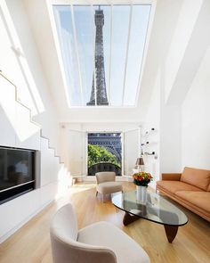 The 'Alexandra et Pascal' is an apartment with mesmerizing views of the Eiffel Tower, Paris, France by Agence Charlotte Féquet