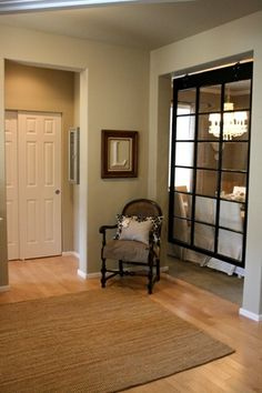 This is a cool idea for separating the entry from the dinning room without the closed in feeling of doors.  Love it! :)