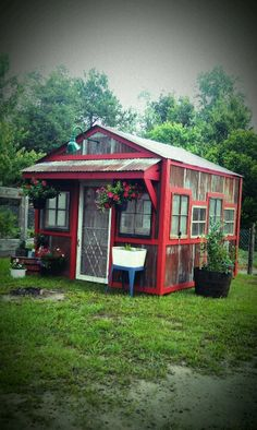 Greenhouse- I love the reclaimed windows, with a unifying paint job.