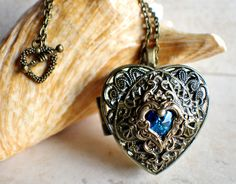 Heart music box locket, heart shaped locket with music box inside, in bronze with blue crystal heart. Star Jewelry, I Love Jewelry, Jewelry Design, Music Jewelry, Hippie Jewelry, Unique Jewelry, Luxury Jewelry, Jewelry Box, Heart Locket