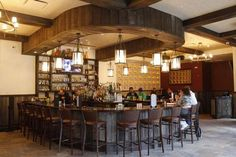 A horseshoe-shaped bar is the centerpiece at Lola's Mexican Kitchen in White Plains .
