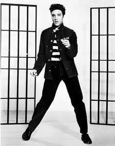 """Photo: publicity photo of Elvis Presley promoting the film """"Jailhouse Rock,"""" 1957. Credit: Metro-Goldwyn-Mayer, Inc.; U.S. Library of Congress, Prints and Photographs Division. Read more on the GenealogyBank blog: """"The 'King' Is Gone: Elvis Presley Dies at Age 42."""" https://blog.genealogybank.com/the-king-is-gone-elvis-presley-dies-at-age-42.html"""