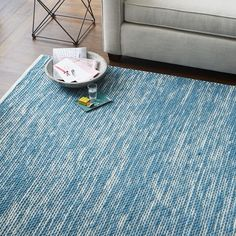 The Painter's Rug features wool, hand-spun by skilled Indian artisans, woven over a 100% cotton base for a soft, textural feel.