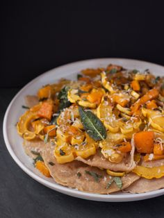 A seasonal show-stopper—homemade whole wheat pasta is stuffed with freshly roasted pumpkin and topped with squash and fried sage.  #italianstylethanksgiving  http://main.colavita.com/roasted-pumpkin-whole-wheat-ravioli-2/