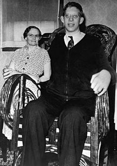 Robert Wadlow and his grandmother.  Note that she's standing and is not as tall as the back of his custom-made chair.
