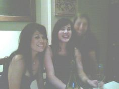 "Pinner: ""A night out with the girls April 4, 2009 ""We have a picture of a staff Christmas party taken over a year ago. There was no one to the right of the girls when it was taken, it's pretty freaky and I am not too sure if it's an over exposure of one of the girls. I thought you should have a look anyway. if you zoom in on the right of the girl you can see the girls face. It would be interesting to find out more."""