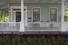 Dark-colored window sashes add interest to a seafoam green Cottage, especially at tulip time.