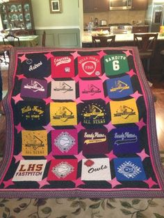 Love this idea to use with old softball jerseys- Softball jersey quilt