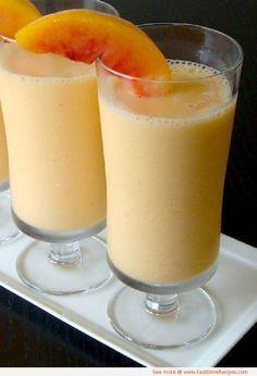 1 c orange juice, 1 c frozen peaches, 1 frozen banana, 2 T toasted sliced almonds. Pecans work well too. Can sub pineapple juice for orange juice.