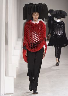 Issey Miyake AW15 - To create the mesh, horizontal bands of material were stacked on top of each other and attached together at offset intervals that created honeycomb-shaped holes when pulled apart.