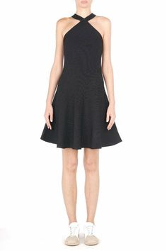 This little black dress with ribbed detail is perfect for spring and summer! The criss-cross neckline is comfortable and lays beautifully.  Pair with your pumps and a light jacket for a stylish night out.    Dry Clean. Criss-Cross Tank Dress by T by Alexander Wang. Clothing Iowa City Iowa