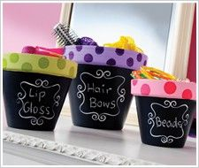 Small flower pots can be used to store odds and ends. Miniature pots could hold paper clips or other office supplies. Paint the flower pot with chalkboard paint so you can label what's inside. Flower pots are labeled with chalk to hold a girl's makeup and hair accessories.