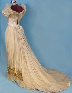 Back, c. 1890 Wedding Gown, Ecru Silk Chiffon over Taffeta Gown Trimmed with Boughs of Wax Lilacs and Point de Venise Lace.