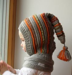 Grey elf hat, Hand Knit Balaclava for Baby, Toddler, Child, Hat with Pom Pom Tail. Made to order sizes Grey elf hat Hand Knit Balaclava for Baby Toddler Child Baby Knitting Patterns, Knitting For Kids, Hand Knitting, Crochet Patterns, Knitted Balaclava, Knitted Hats, Elf Hut, Hood Pattern, Knit Crochet