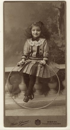 This vintage photograph features an adorable little girl sitting on a wall and holding her hoop toy. She is wearing a cute dress and is wearing a bow in her long wavy hair. She is also wearing a wo… Antique Photos, Vintage Pictures, Vintage Photographs, Vintage Images, Old Photos, Little Girl Photos, Cute Little Girls, Edwardian Era, Victorian
