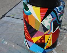 Art on street level - more colors on public trash cans.