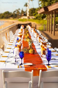 Cobalt Blue and Orange Wedding theme, pineapple theme, Maui Wedding Photo by MeewMeew Studios  Wedding at El Dorado by CJ's Catering Day of Wedding Coordinator Tori Rogers of Hawaii Weddings by Tori Rogers www.hawaiianweddings.net Maui Wedding Location