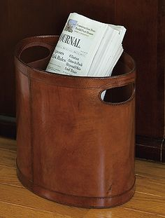 """Leather Wastebasket  A stitched leather covered wastebasket for the last word in paper disposal. Fabric lined, top workmanship for the elegant look in an office or study. 12"""" x 13"""" x 9""""  Item #: 40403,  Price: $195.00"""