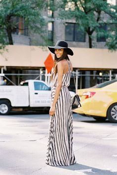 Love the mix of the very summery maxi dress and wool floppy hat