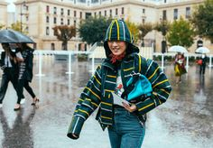 Justine Lee in a Sacai jacket and Sandro jeans with a Loewe bag